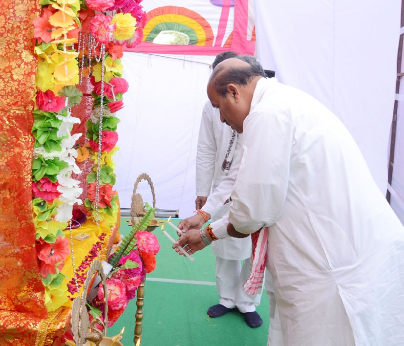 Hon'ble State Minister of Government of India-Women & Child Development and Minority Affairs Dr. Veerendra Kumar is lighting the lamp