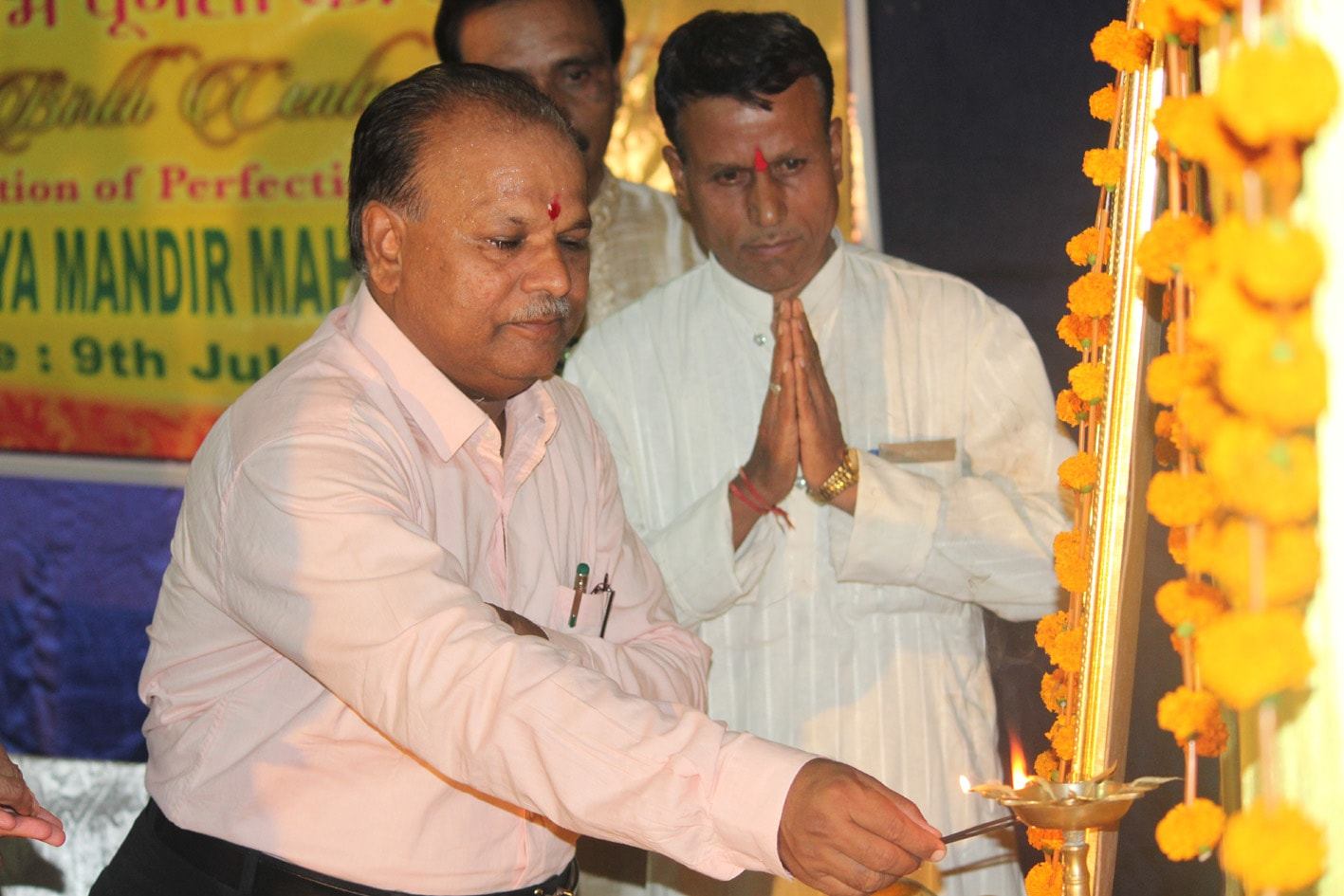 chief guest shri r k khare principal of pg college mahasamund is lighting the lamp