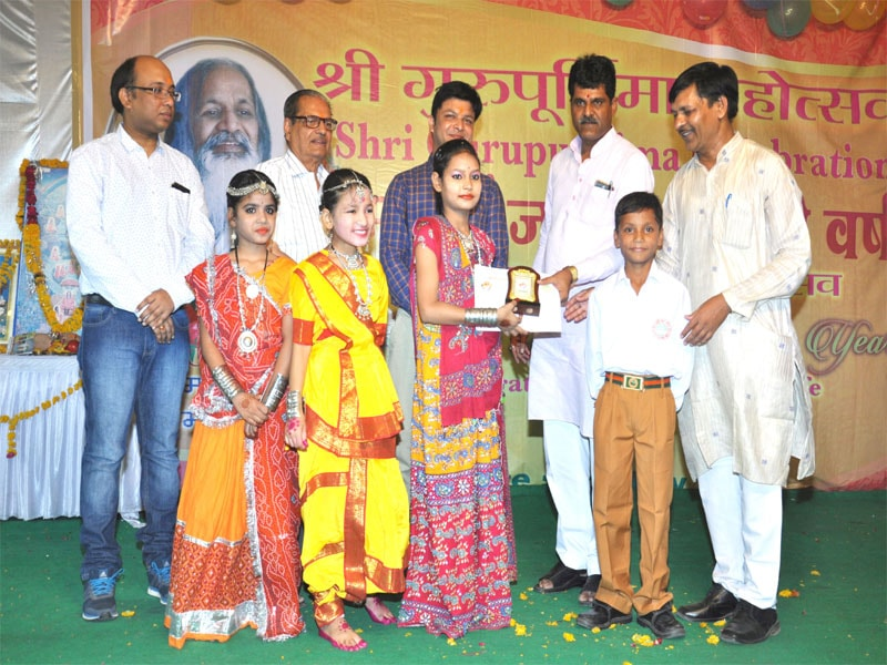 honble mla has honoured with special award to of mvm shajapur students for dance performance