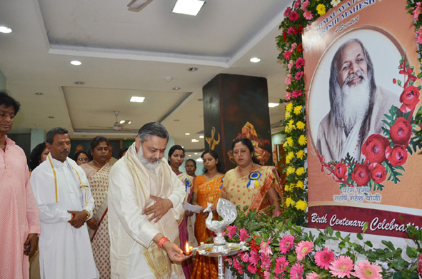 4at the entrance of auditorium beautiful exhibition was displayed, where Brahmachari girish ji has lighted the lamp