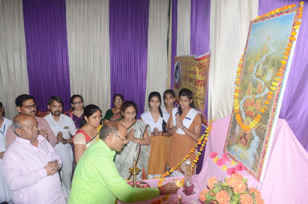 teachers and students are performing guru parampara pujan